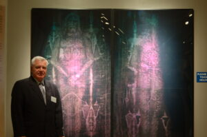 fig. 15 Dr. P. Soons in front of Life Size Holograms