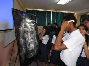 The public is using 3D glasses to see the 3D in the anaglyph photos of the head, front and back of the body, during presentation and expositions.