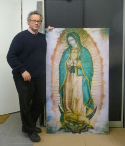Photograph 2 - Walter Spierings Director of Dutch Holographic Laboratory with lenticular of the Virgen of Guadalupe