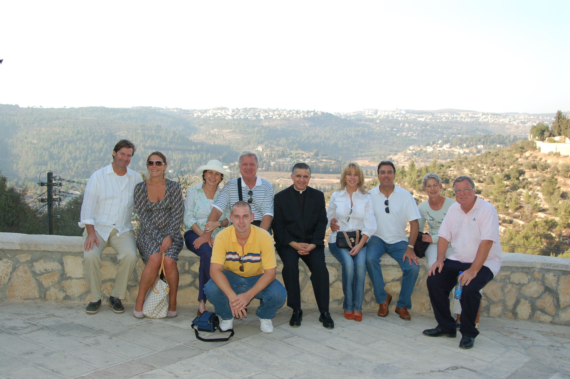 Father Hector Guerra with sponsor group in Israel