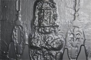 Figure 6. Museo della Sindone vertical relief under beard in bronce bas-relief