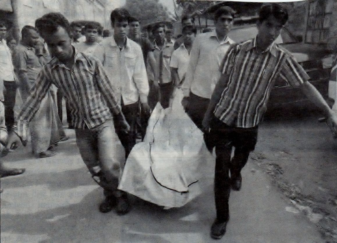Photo 4. Six people carrying dead body