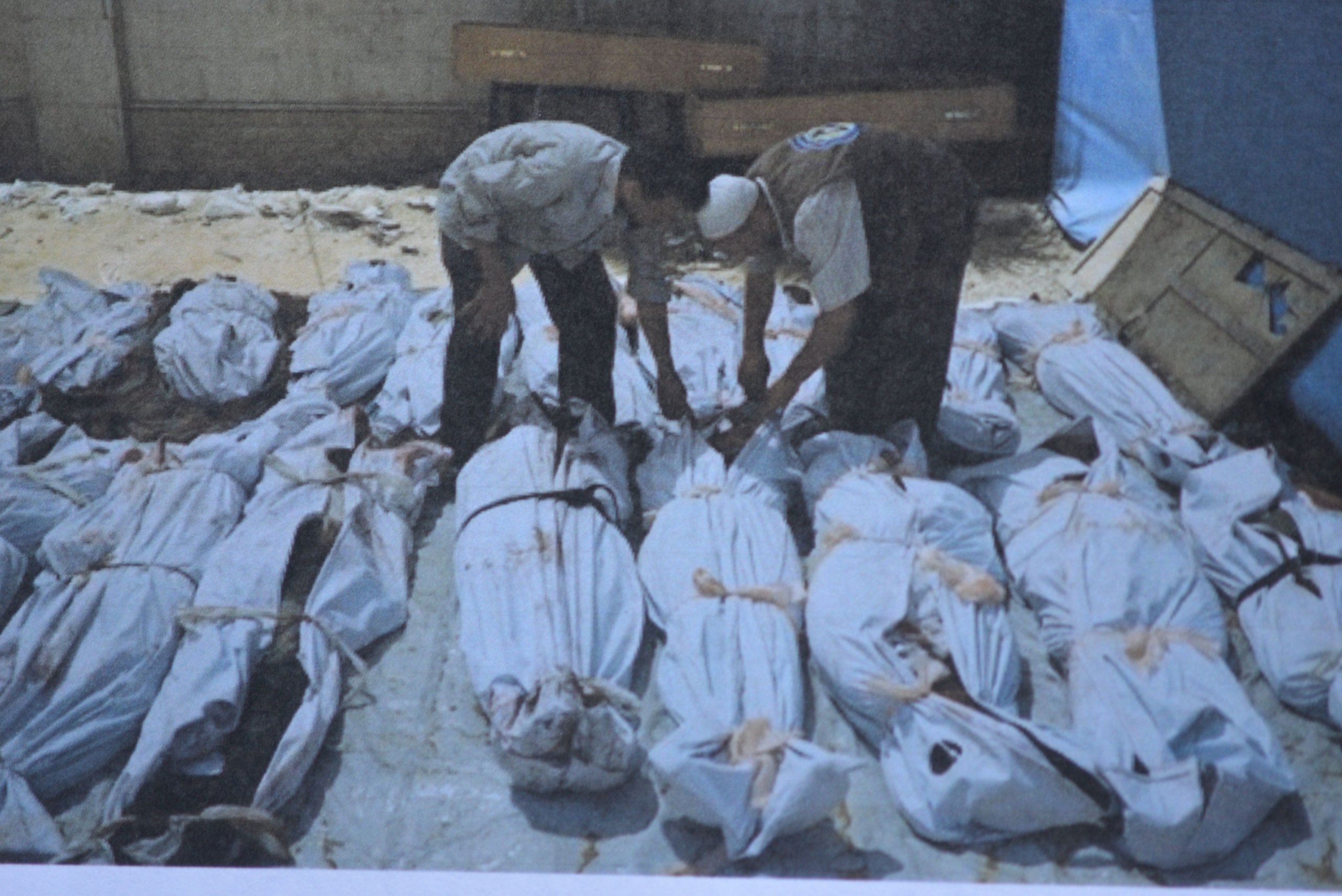 Photo 5. Shrouded bodies Middle East